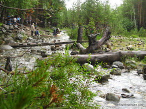 Photo: The sacred stream and the devout at Arshan