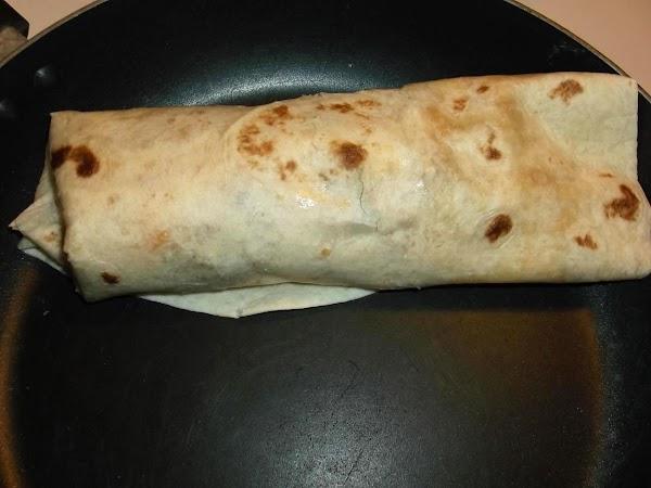 Leave burrito in skillet, seam side down, for a few seconds.