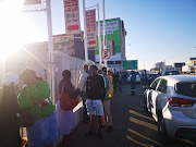 An early queue outside Liberty Liquors in Durban.