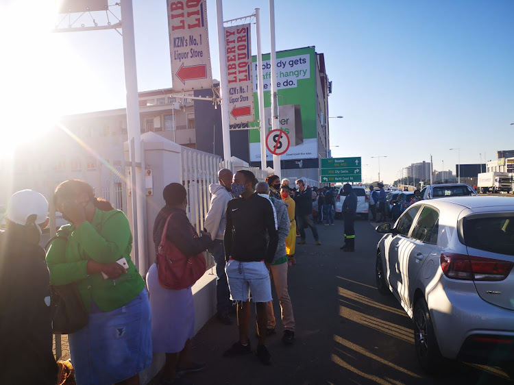 Scores of masked customers line up outside Liberty Liquors in Durban on Monday morning to get their hands on much-awaited alcohol.
