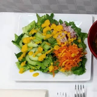 Fresh Vegetable Salad with Miso Carrot Ginger Dressing.