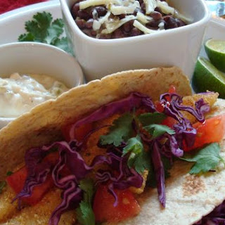 Corn-Crusted Fish Tacos With Jalapeno-Lime Sauce and Spicy Black Beans