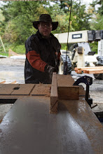 Photo: Pouring rain out.  We set up the saw in the garage (semi less wet) to start cutting bevelled plates for the I-joists to land on.