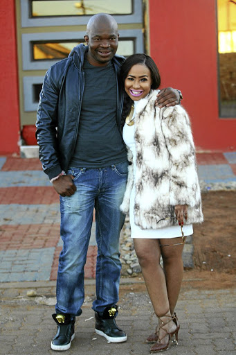 Thuthukani Mvula and singer Mshoza say they're happy even though they are facing court action from his estranged wife, Duduzile. / Veli Nhlapo