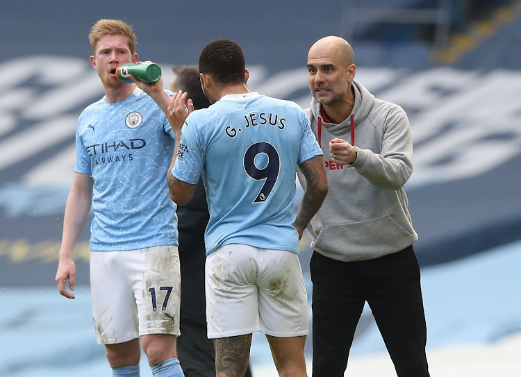 Manchester City manager Pep Guardiola speaks to Gabriel Jesus