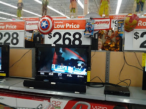 Photo: Heading to the electronics to get the DVD, I saw all the display TVs were playing the new movie.