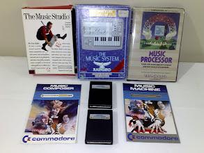 Photo: Various C64 music software : The Music Studio, The Music System (Rainbird), Music Processor (Sight & Sound), Commodore Music Composer & Music Machine carts
