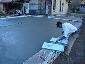 Photo: Loren making floater boards so he can spread his weight on the concrete while finish troweling.