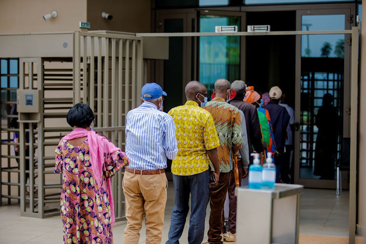 Rwandans line up to get Covid-19 vaccinations, with the AstraZeneca, Pfizer-BioNTech and Moderna vaccines in hand.