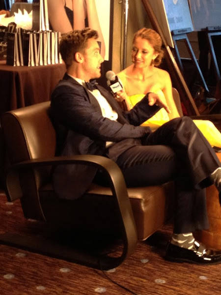 Photo: Lance Bass gets interviewed about the Thirst Project in the Alvar Aalto Bentwood Lounge Chairs with Take Part! — at The Beverly Hilton.