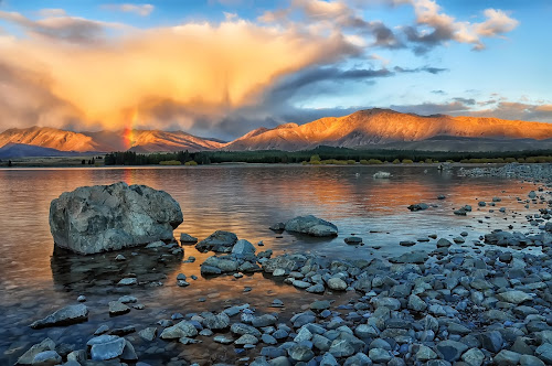 Lake Tekapo, New Zealand by Phattana Sangsawang - Landscapes Waterscapes ( reflection, old, brick, landscape, panorama, mirror, mountains, southern, sky, nature, camping, sunny, sunshine, zealand, lakeside, rocks, alps, water, green, lake, quiet, postcard, highlands, holiday, glacier, pure, blue, sunset, serene, tekapo, summer, scenery, glacial, fishing )