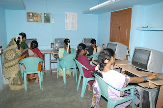 Photo: Young women trainees busy attending a practical sesstion