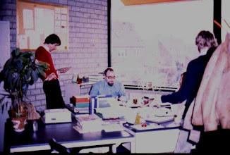 Photo: at desk: Sjef van Rooy