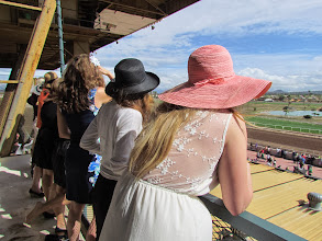 Photo: Attendees gather at the terrace to watch live racing