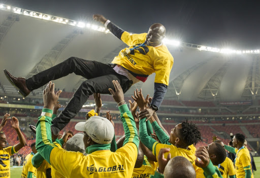 Beroka FC players celebrating their win by throwing Witson Nyirenda, head coach of Baroka FC, in the air during the Telkom Knockout Final match between Baroka FC and Orlando Pirates at Nelson Mandela Bay Stadium on December 08, 2018 in Port Elizabeth.
