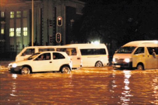 STRANDED: Williams Road in Durban was flooded yesterday following heavy rainstorms that hit the province, causing major delays in traffic. Pic: THULI DLAMINI. 17/02/2010. © Sowetan.