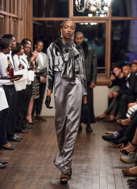 David Tlale showed a metallic-coloured range in silky fabrics teamed with silver stoles and feathered corsets