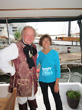 Photo: Rafael and Ellen on our Boatel in front of his tall ship