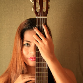 With Strings Attached by Bong Flores - People Musicians & Entertainers ( girl, woman, guitarist, strings, guitar, beauty, classic )