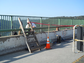 Photo: paint removal from vehicular railing