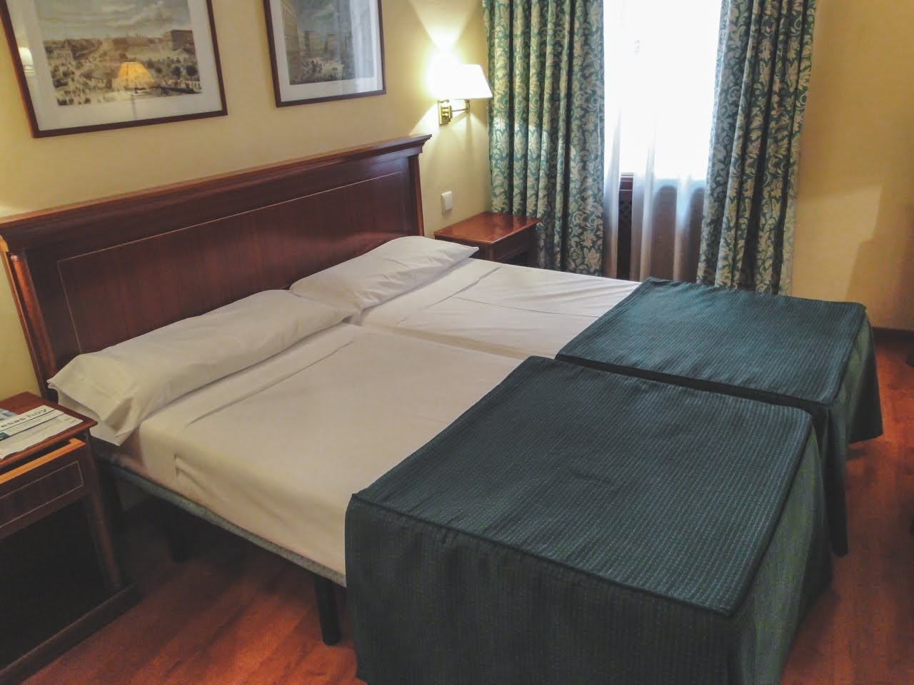 Our hotel room in Madrid Spain, Hotel Tryp Rex, had two small beds without much padding