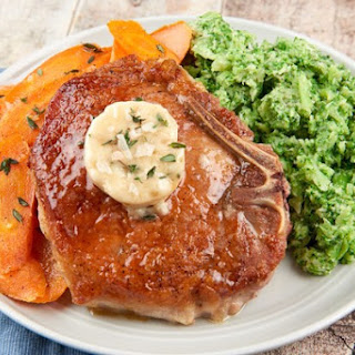 Bone-In Pork Chop with Smoky Maple Butter with roasted carrots and broccoli mash