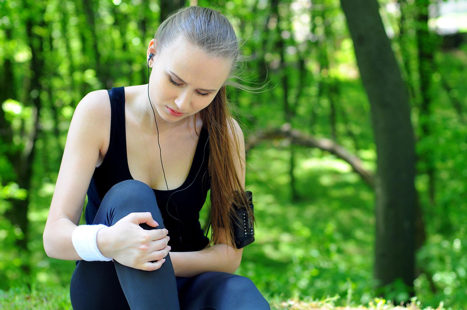 Female runner battling a sore knee