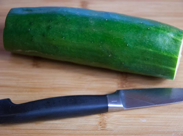 While the brine is simmering, wash and dry the cucumbers, and cut off the...