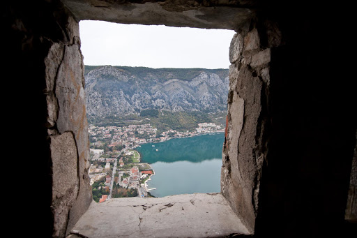 Kotor-through-window.jpg - Kotor as seen through a window in the abandoned Castle of San Giovanni (or the Castle of St. John as English-speaking tourists call it).