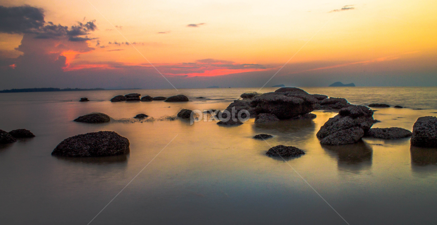 A silent sunset by Victor Sim - Landscapes Sunsets & Sunrises ( water, sky, sunset, reflections, rocks )