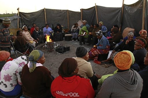 Homeless:  Residents of an informal settlement in Philippi meet  after their homes were torn down by city officials.     Picture: ELVIS KA NYELENZI