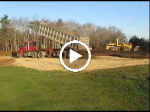 Video: 12-30-2011 8:45 am. video 0:44 minutes.   Adding 6 inches of 50/50 (sand/loam) top mix.