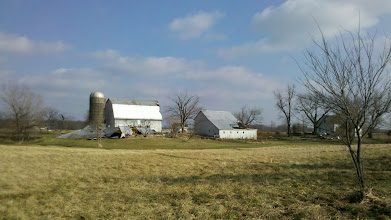 Photo: The neighbor's barn was leveled by the 120mph winds.