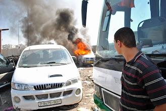 Photo: A truck is set ablaze at Qalandiya checkpoint.