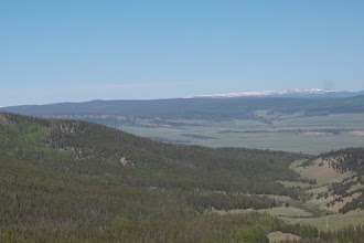 Photo: Looking W across Cochetopa Park.  The snow is on top of Cannibal Plateau, but at the L, Uncompahgre Pk (14,309') is showing, about 50 miles away.  This whole area is the La Garita caldera.  25 million years ago it blew up and expelled 3,000 cubic MILES of ash, scoria, lava, etc.  On the volcanic activity scale of 1-8 it is rated 9.2!