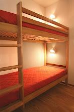 Photo: Une chambre avec lits superposés d'un appartement 3 pièces pour 8 personnes en duplex