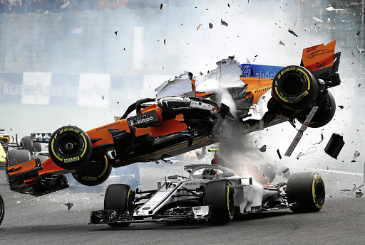 Fernando Alonso's McLaren, above, flies over Charles Leclerc's Sauber after being rammed by Renault's Nico Hulkenberg on the first corner of Sunday's Belgian Grand Prix. Picture: REUTERS