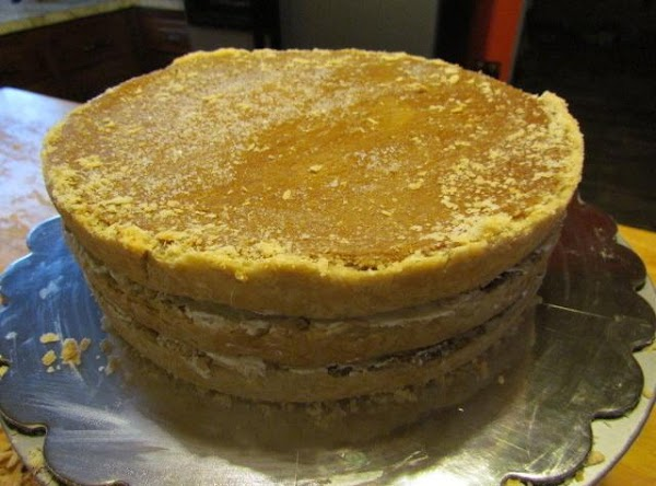 Start stacking one at a time with the crust down putting a thin layer...