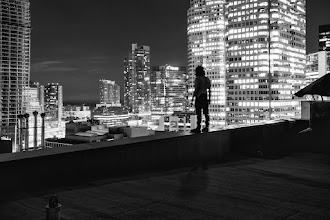 Photo: On the Brink Even pros sometimes say they become weak in the knees. Pictured is +Ryan Emond, pre-bust.  ISO: 200 Shutter: 25 seconds Aperture: F/8 Camera: Canon 5d Mk II Lens: Canon 17-40mm L  #toronto  #rooftopping #portrait #silhouette #skyline #urbex #urbanexploration