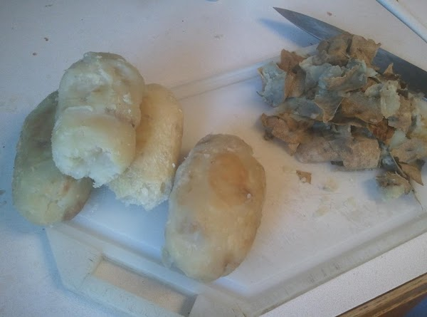 Clean, stab ends of potatoes with fork, slather with shortening and bake at 400*...