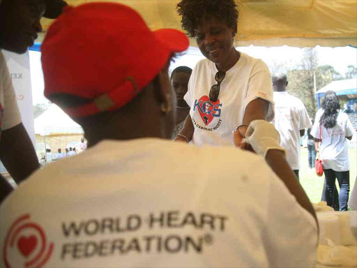 A woman undergoes an examination at Railways Club during a function to mark World Heart Day, September 29, 2013.