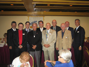 Photo: Incoming Officers and Board Members - Dennis Robinson (Vocational Service), President-Elect Dennis Micare, Sher Weisman (Club Service), Paul Treusch (Sergeant-at-Arms), Secretary Joe Alemany, PRESIDENT BLAINE TIMMER, Vice President Bill Ottinger, John Brim (International Service Director), District Governor Bill Griffin,  Immediate Past President Joe Johnson