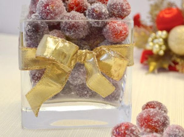 Place sugar in a bowl and gently toss cranberries , coating well and evenly....