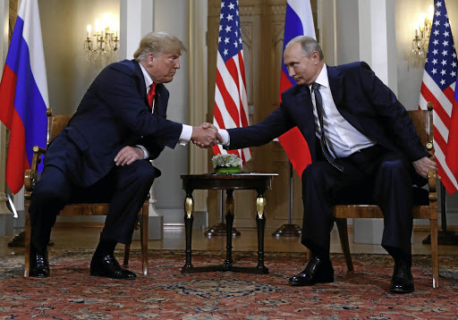 Mutual admiration: US President Donald Trump and Russia's President Vladimir Putin shake hands as they met in Helsinki, Finland on July 16. Putin says forces in US trying to undermine the relationship will not succeed. Picture: REUTERS