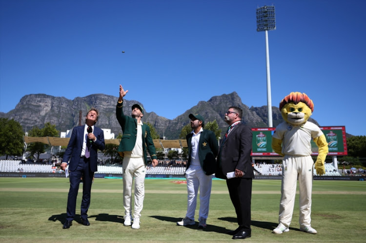 South African captain Faf du Plessis tosses the coin as Pakistan captain Sarfraz Ahmed calls and Match Referee David Boon looks on during day 1 of the 2nd Castle Lager Test match between South Africa and Pakistan at PPC Newlands on January 03, 2019 in Cape Town, South Africa.