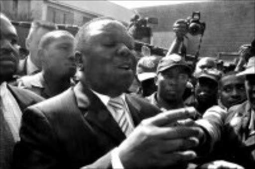 TOLERANCE PLEA: MDC leader Morgan Tsvangirai talking to displaced foreigners at Alexandra police station yesterday. Pic. Lucky Nxumalo. 22/05/2008. © Sowetan