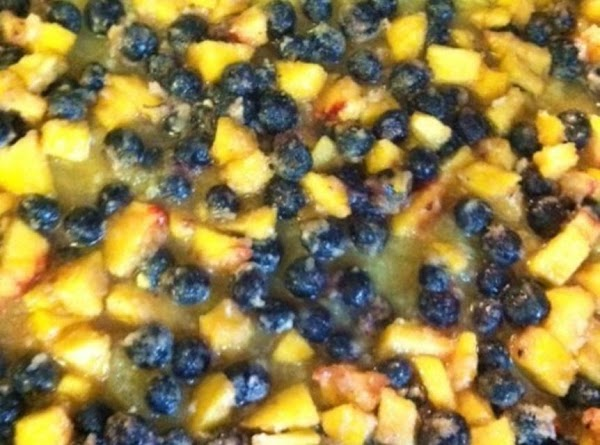 pour berry peach mixture over the pineapple evenly. Mix 1/2 cup of pecans in...