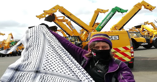 Children's charity under pressure for accepting JCB's 'dirty money'