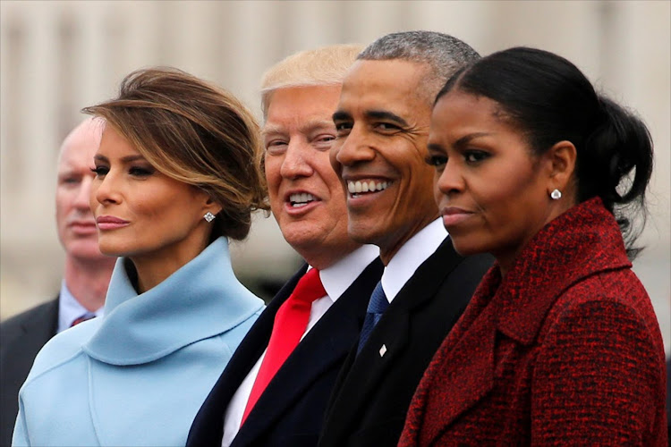 U.S. President Donald Trump and first lady Melania Trump see off former U.S. President Barack Obama and his wife Michelle Obama as they depart following Trump's inauguration at the Capitol in Washington, U.S. January 20, 2017. REUTERS/Jonathan Ernst