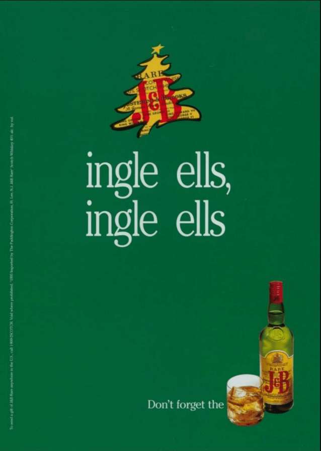 """A green JB Whiskey ad, with """"ingle ells, ingle ells"""" written on top and a tagline of """"Don't forget the J&B""""."""